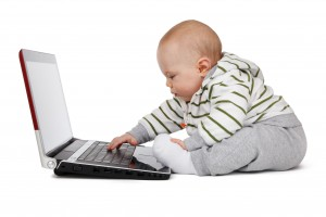baby_working_on_a_laptop_204936